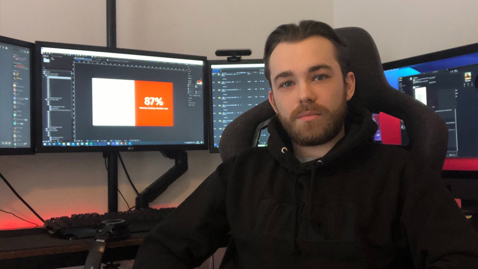 Motion Graphics Designer Oscar Gilbert at his workstation